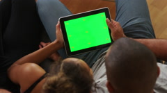 African couple holding tablet with greenscreen Stock Footage