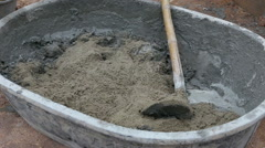 Labor mixing concrete for construction job Stock Footage