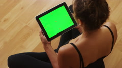 African American woman watching videos on tablet Stock Footage
