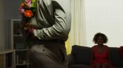 African boyfriend surprises girlfriend with flowers Stock Footage