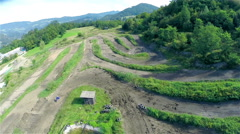 Air shot of almost empty motocross track by the forest Stock Footage