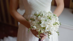Bride held weddig bouquet in her arms - stock footage
