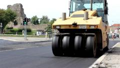 Yellow steamroller. Paving and compacting new asphalt, roller flattens asphalt. Stock Footage