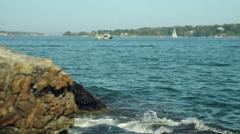 Ocean waves crash against scenic rocky Maine coast, slider shot Stock Footage