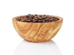 Roasted coffee beans in olive wood bowl Stock Photos