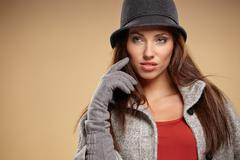 Young brunette woman in autumn color. Studio shoot - stock photo
