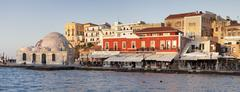 Venetian port and turkish mosque hassan pascha at the old town of chania, cre Stock Photos