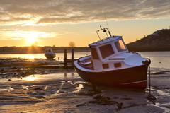 View towards the aln estuary during a stunning winter sunrise from the beach  Stock Photos