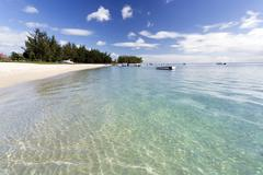 View along flic en flac beach showing the clear shallows of the indian ocean, Stock Photos