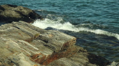 Ocean waves crash against scenic rocky Maine coast, close up Stock Footage