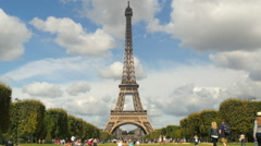People on the Champ de Mars in front of the Eiffel Tower - stock footage