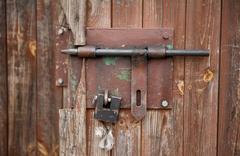 sliding bolt unlocked and padlock - stock photo