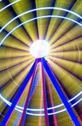 Beautiful long exposure picture of a ferris wheel rotating, vivid colors. Stock Photos