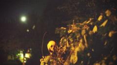 grainy skeleton monster behind trash - stock footage