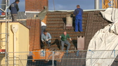 Stock Video Footage of 4K TL Contractors Construction workers roofing repairing Roof tiles Shingles
