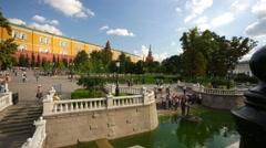 Stock Video Footage of Tourists walk in Alexander Gardens near Kremlin.