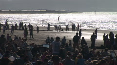 Traditional English holiday beach with many people in evening light Stock Footage