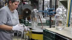 Glassworks. Glassware factory. Gas burner cut unnecessary excess of glass - stock footage