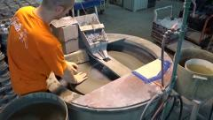 Glassworks. Glassware factory. Employee polishes glass Stock Footage