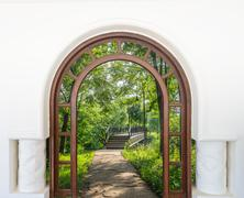 Open door arch with access to the alley Stock Photos