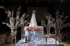 Stock Photo of beautiful white wedding cake luxury in marriage ceremony