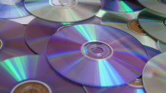 CDs and DVDs On the Table Stock Footage