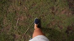 Female Legs in Street Slippers Walking on Green Grass. Slow Motion. Stock Footage