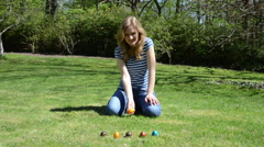 Girl have fun playing Easter game with painted colorful eggs Stock Footage