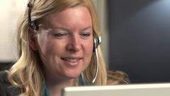 Female call center employee talking, dolly Stock Footage