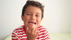 Child showing missing teeth Stock Footage