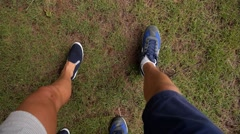 Closeup of Male and Female Legs Walking Together. Slow Motion. Stock Footage