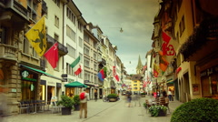 Old street in Zurich decorated with flags, time lapse, 4k Stock Footage