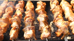 Pork skewers on the grill - stock footage