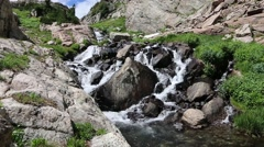 Mountain Stream Cascading Through Boulders Stock Footage