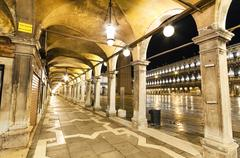 Stock Photo of archway at night in st marco square, venice, italy.