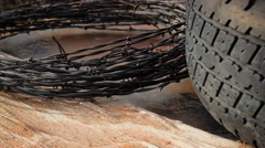 Old Tire and Barbed Wire - stock footage