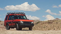 Land Rover Adventure Moab in Wild Landscape Parked Wider Shot Stock Footage