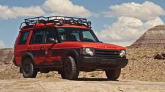 Time Lapse of Coulds with Land Rover Adventure Moab in Wild Landscape Parked Stock Footage