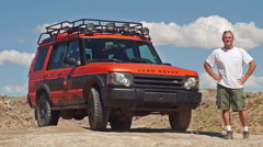 Land Rover Adventure Moab in Wild Landscape Parked with Man Stock Footage