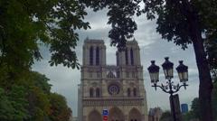 Notre Dame de Paris behind trees Stock Footage