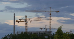 UltraHD 4K Building Under Construction Site Cranes Silhouettes Sunset Daylight Stock Footage