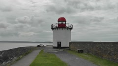 Burry Port Lighthouse with a cloudy sky in the background Stock Footage