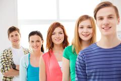 Smiling male student with group of classmates Stock Photos