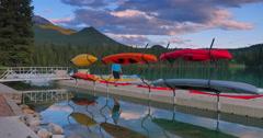 4K Dusk Reflection, Canoes on Lake at Sunset, Jasper Park Lodge, Alberta Stock Footage