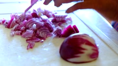 Cook chopping red onions with knife Stock Footage