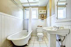Claw foot tub in white bathroom Stock Photos