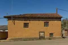 Old adobe house in village Stock Photos