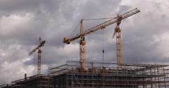 Ultra HD 4K Heavy Lifting Construction Cranes Industry Building Silhouettes Stock Footage