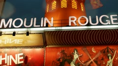 Tilt Moulin Rouge Cabaret night club in the Pigalle neighborhood, Paris France Stock Footage