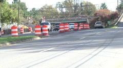 Traffic moving past cones road work Stock Footage
